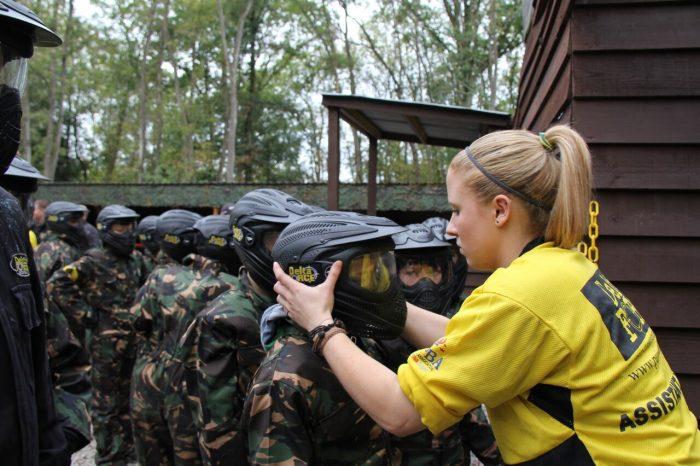 Delta Force marshal checks children's helmets
