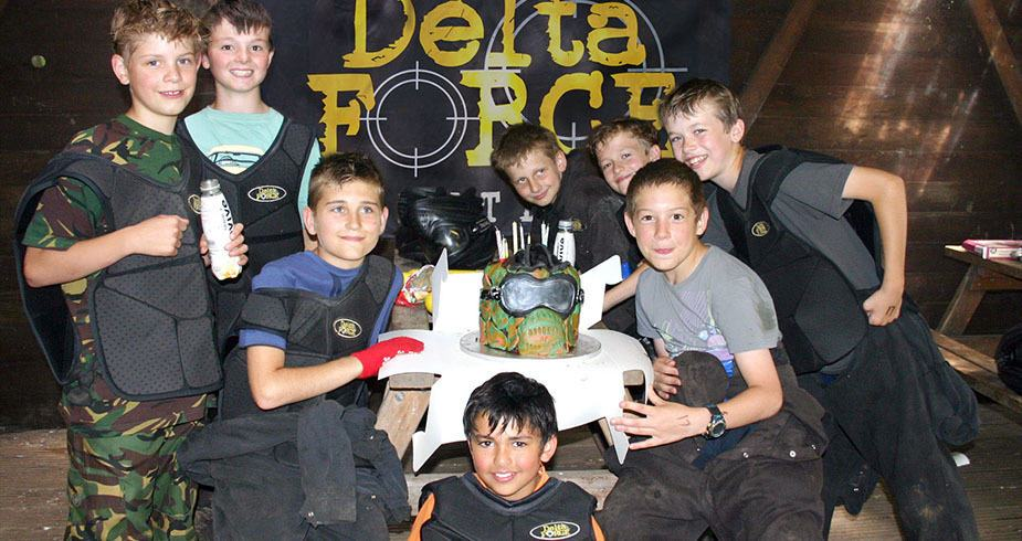 Boys Pose With Delta Force Paintball Body Armour