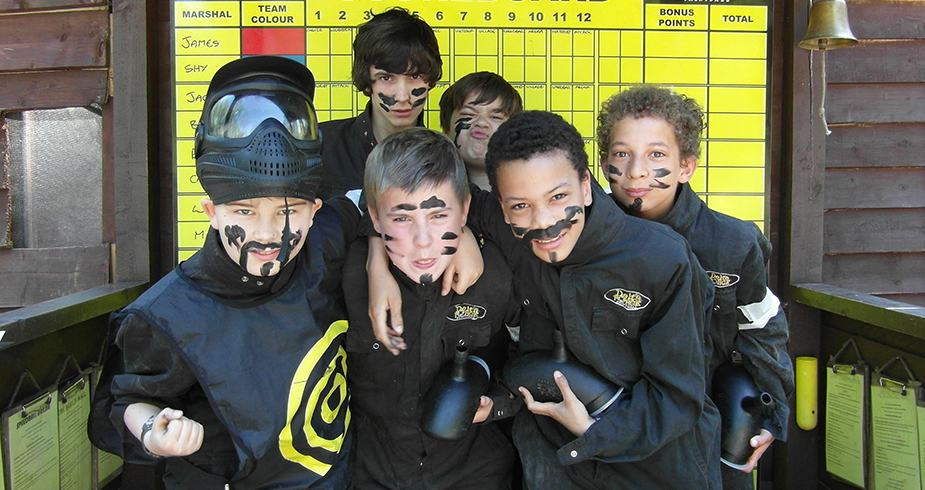Boys Pose With Face Paint And Delta Force Paintball Uniform