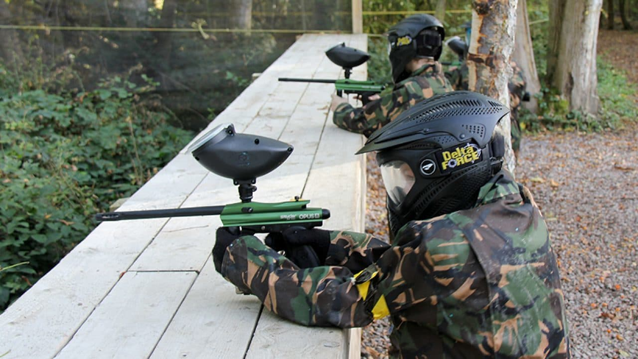 mini paintball players targeting opponents
