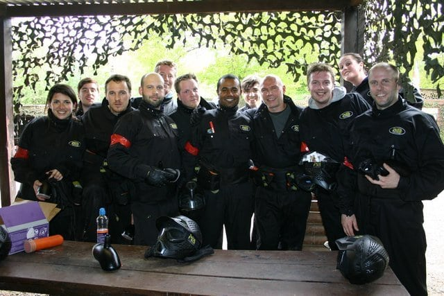 Colleagues Pose In Delta Force Paintball Gear