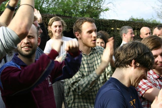 Group Of Men Clapping And Cheering