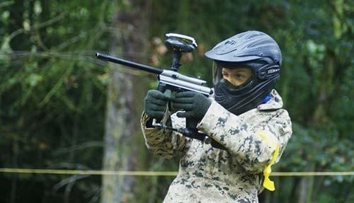 Kid Aiming Delta Force Paintball Gun