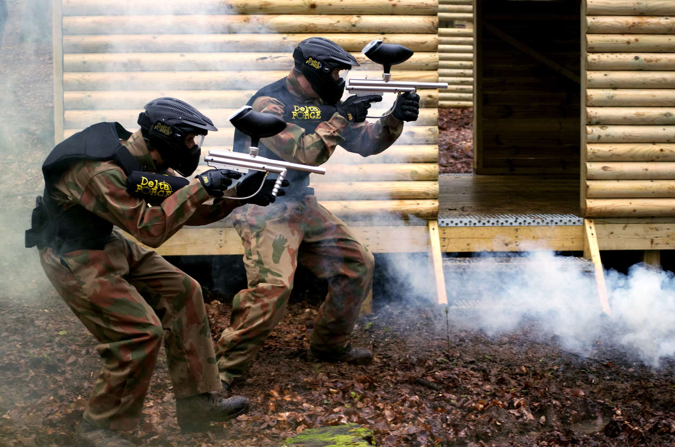 Two Paintball Players Advance on Hut Doorway in Hampshire Paintball