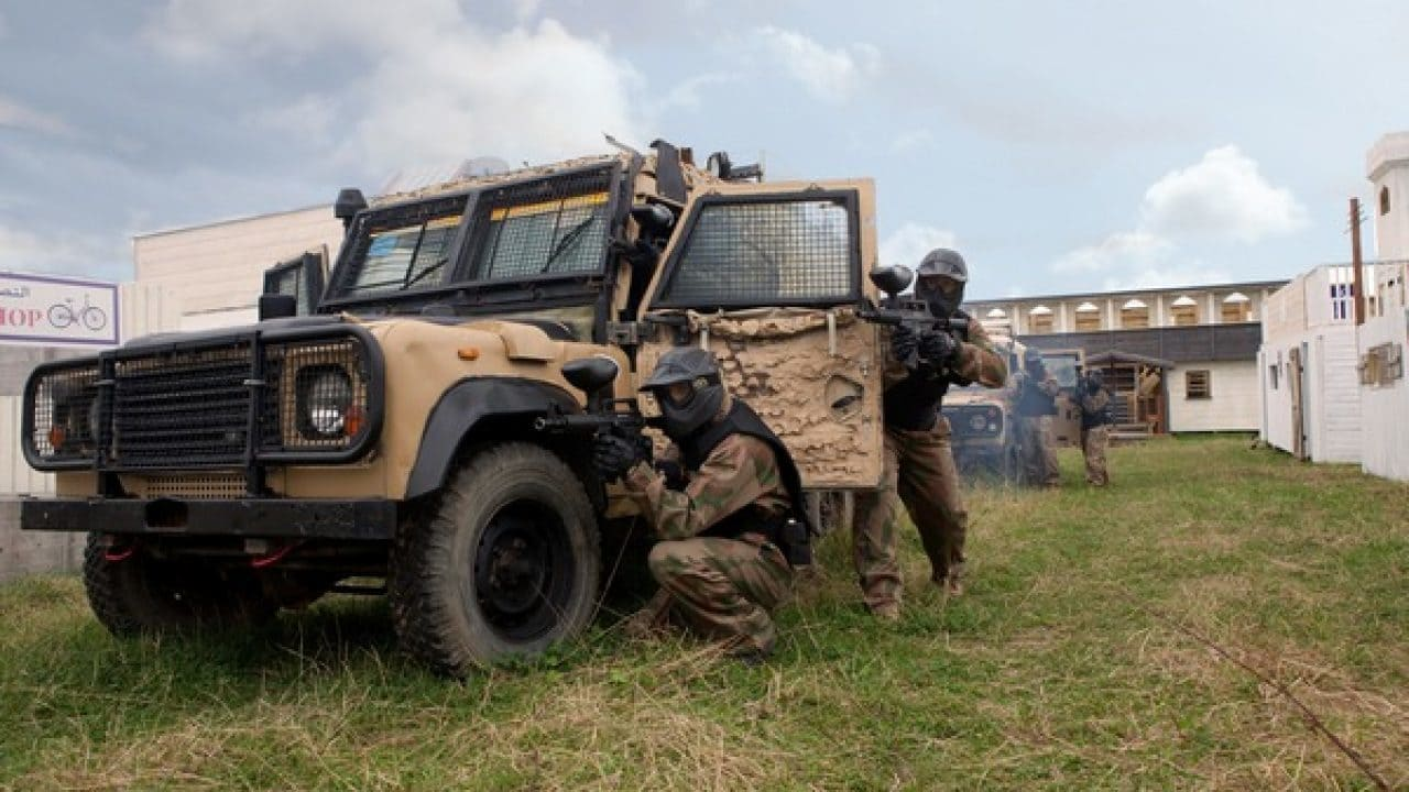 Delta Force Players Crowded Round Military Vehicle