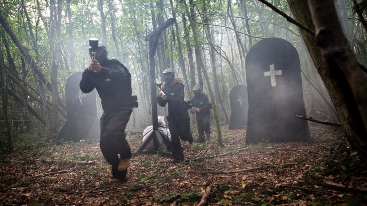 Players Run In Woods With Smoke And Grave Prop