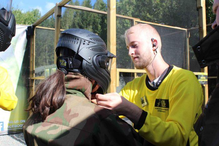 Marshal adjusts player's helmet