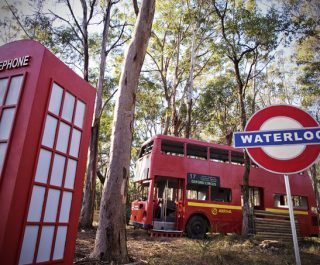 Waterloo sign, abandoned bus, and telephone box