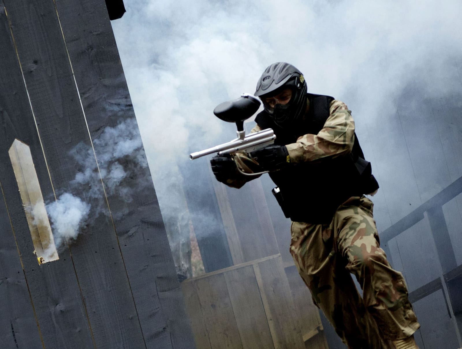 Paintball Player Storms Castle Surrounded by Smoke