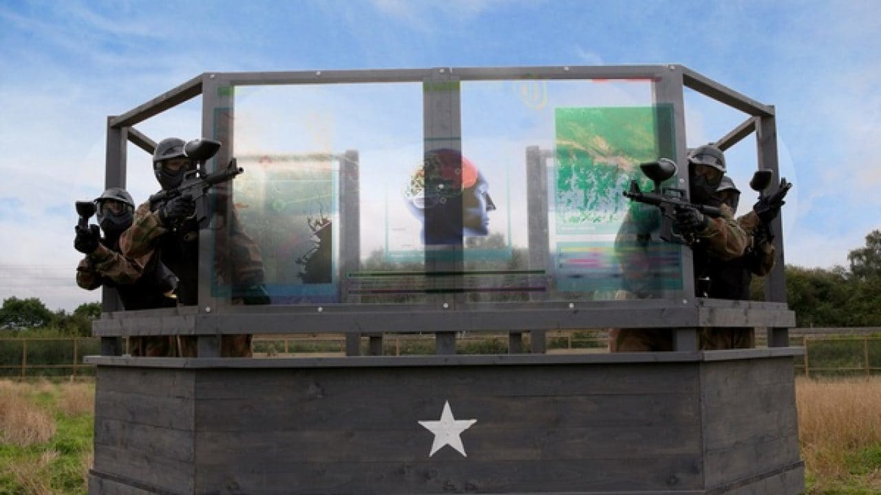 Delta Force players take cover behind outpost window