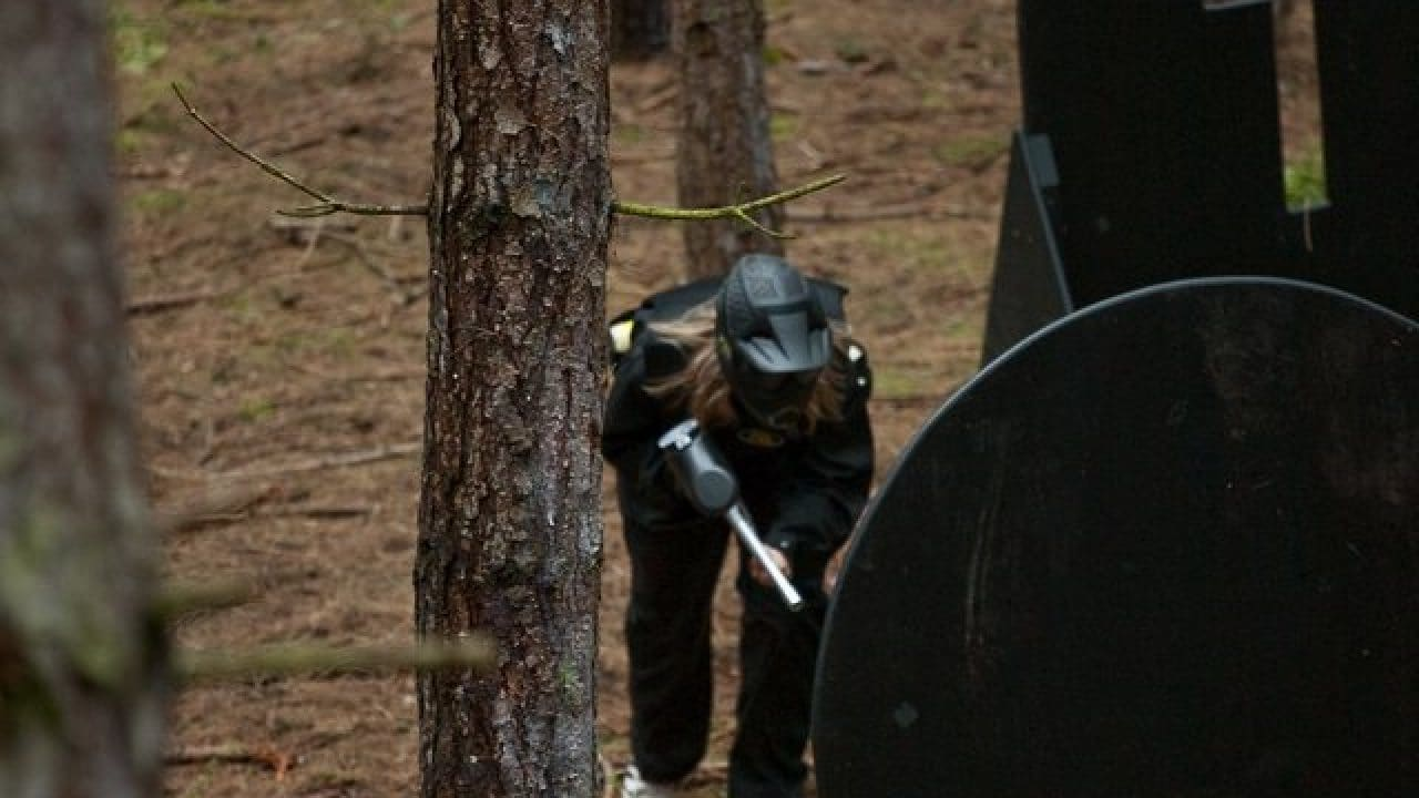 Delta Force Player Crouches In Woods