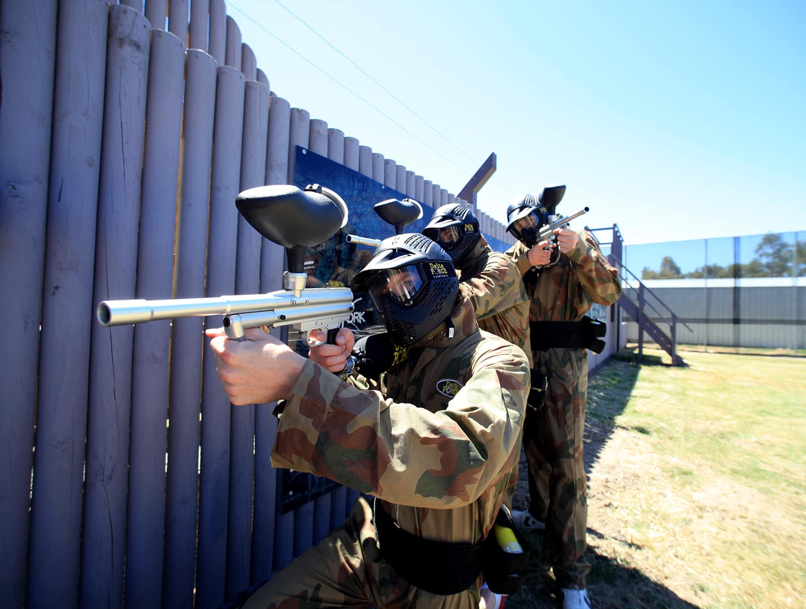 Three Players Pose By Berlin Wall Game Zone at Paintball Manchester