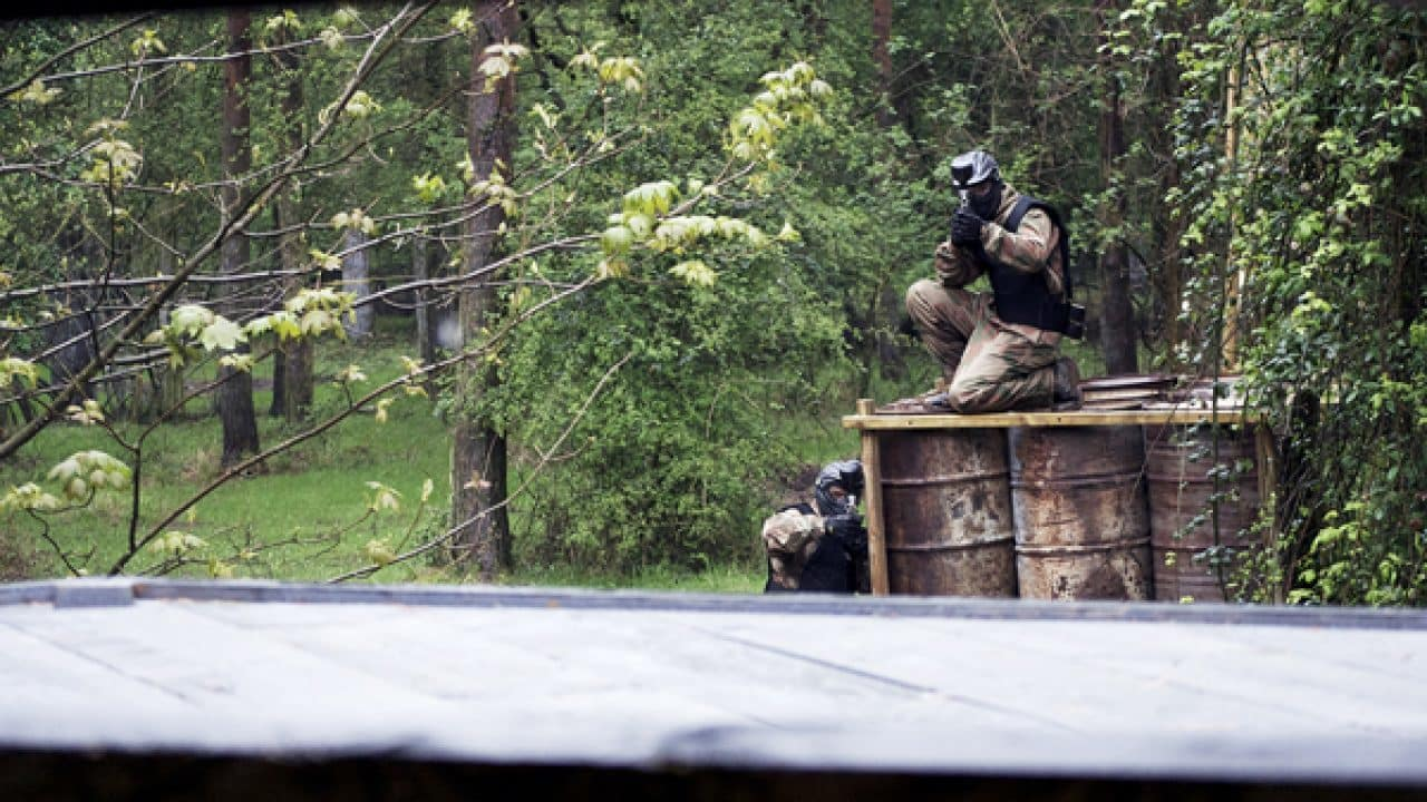 Delta Force Players On Top Of Barrels