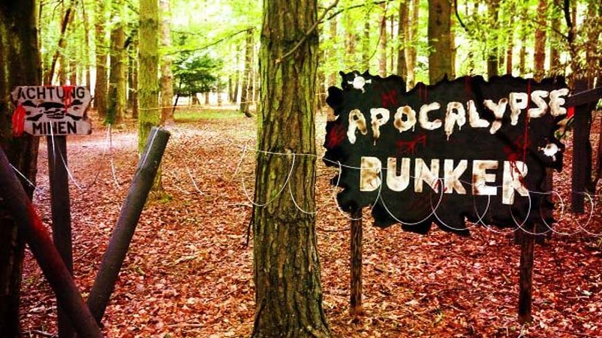 Derelict sign bearing 'Apocalypse Bunker' game zone title