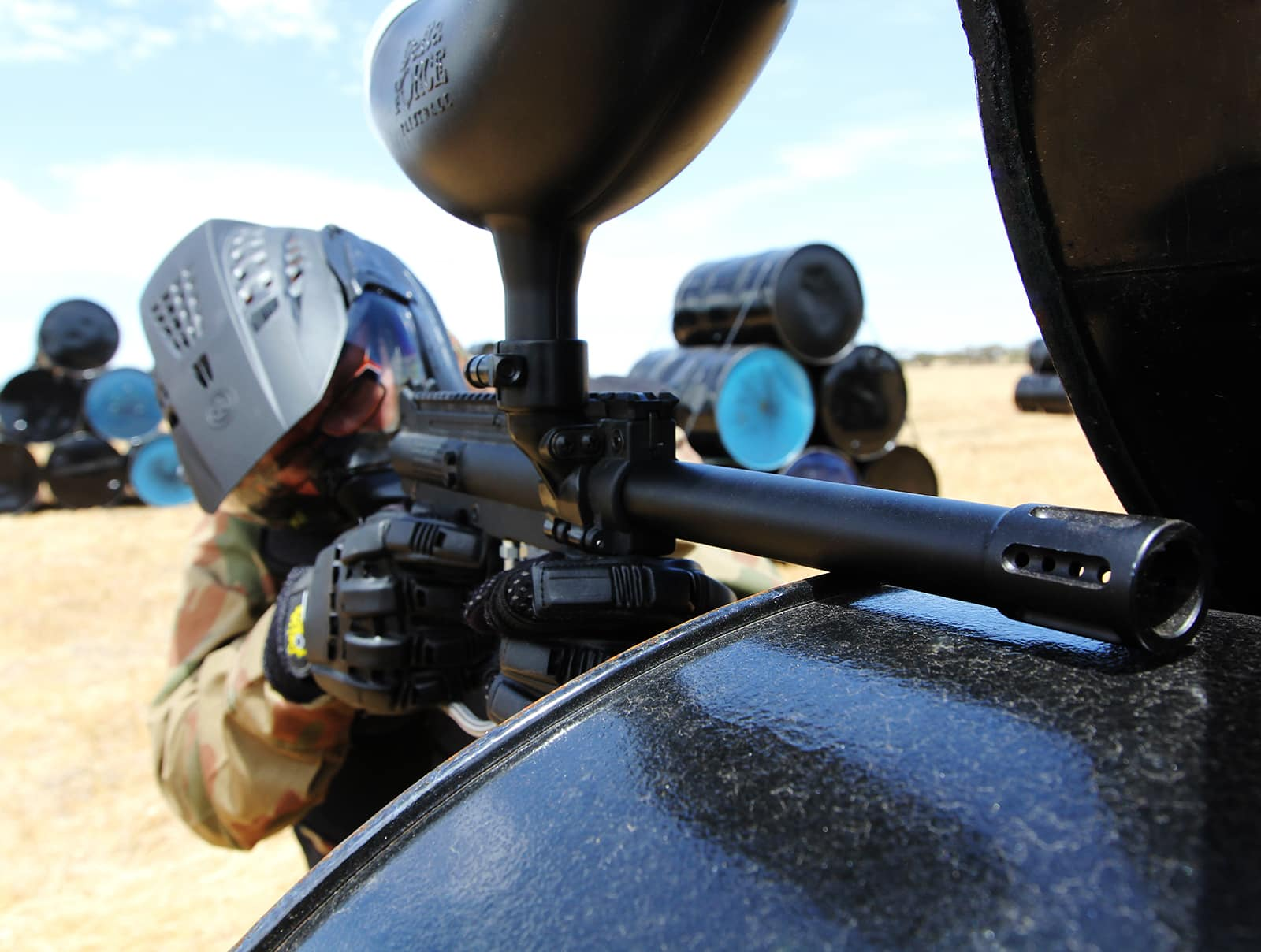 Player at Yorkshire Paintball Centre Looking Down The Side Of Paintball Gun