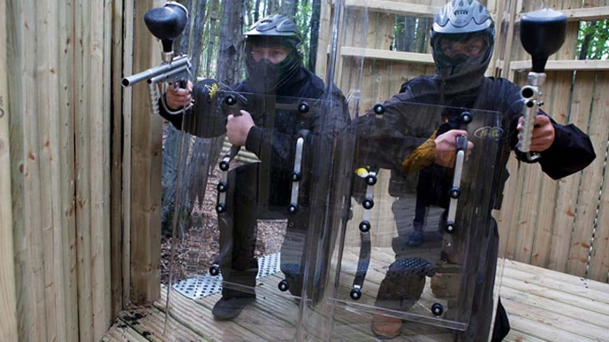 Delta Force Paintball Players Use Shield At Command Post