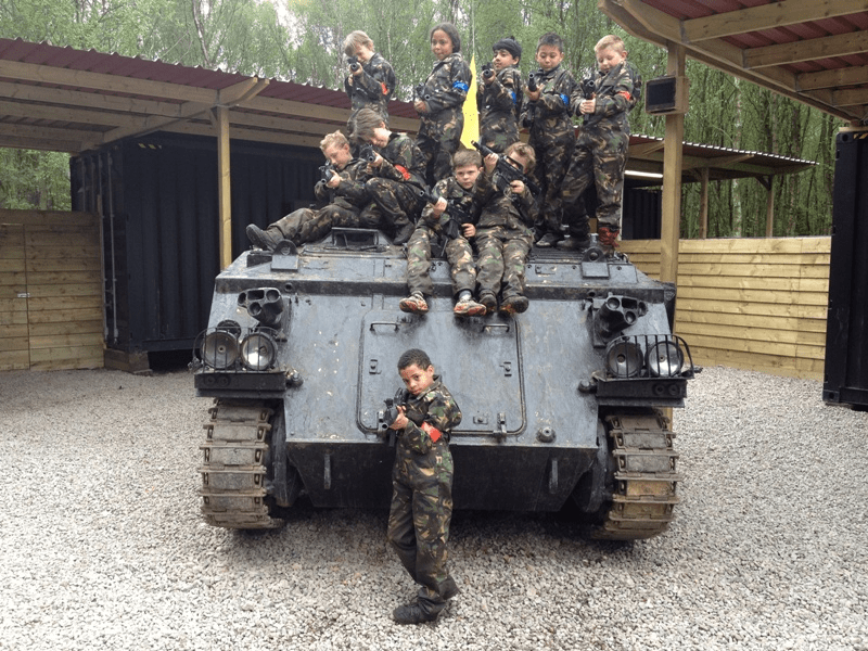 Kids Pose On Top Delta Force Military Vehicle