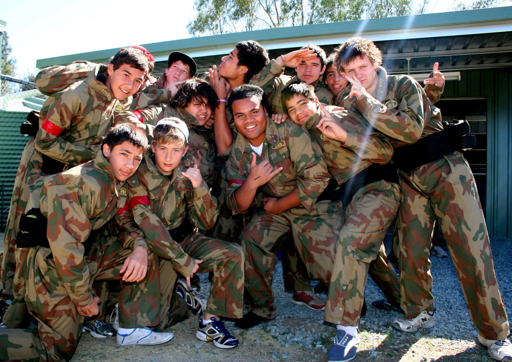 Boys Posing In Delta Force Paintball Camouflage Uniform