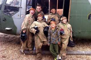 Kids In Paintball Kit In Front Of Sea Lynx Helicopter