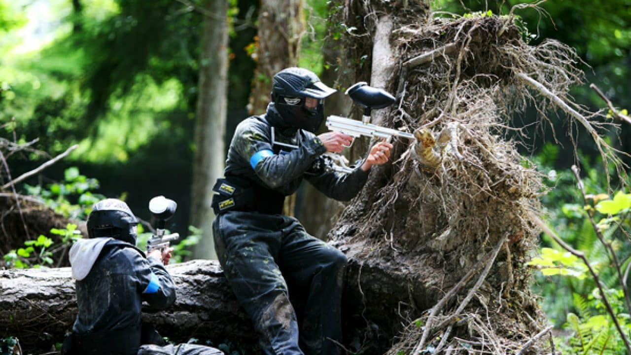 Delta Force Paintball Players Using Woods As Cover