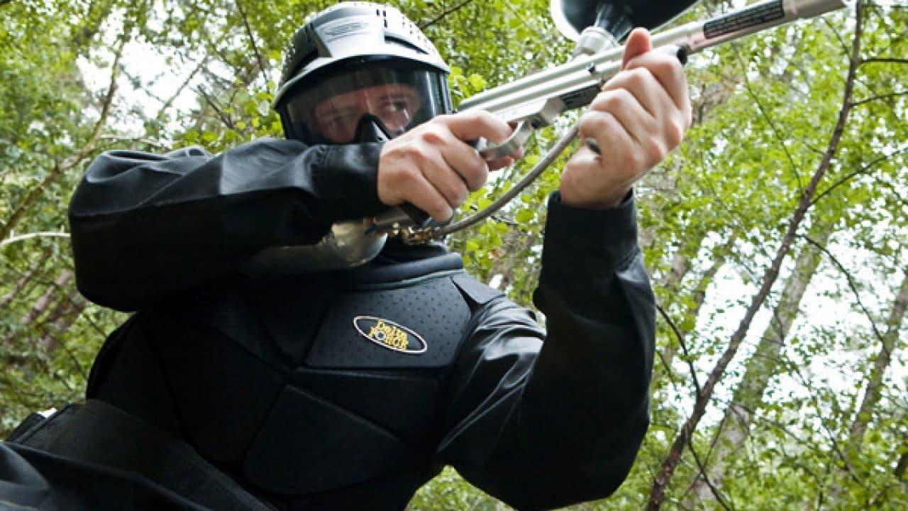 Delta Force Player In Body Armour Raising Paintball Gun