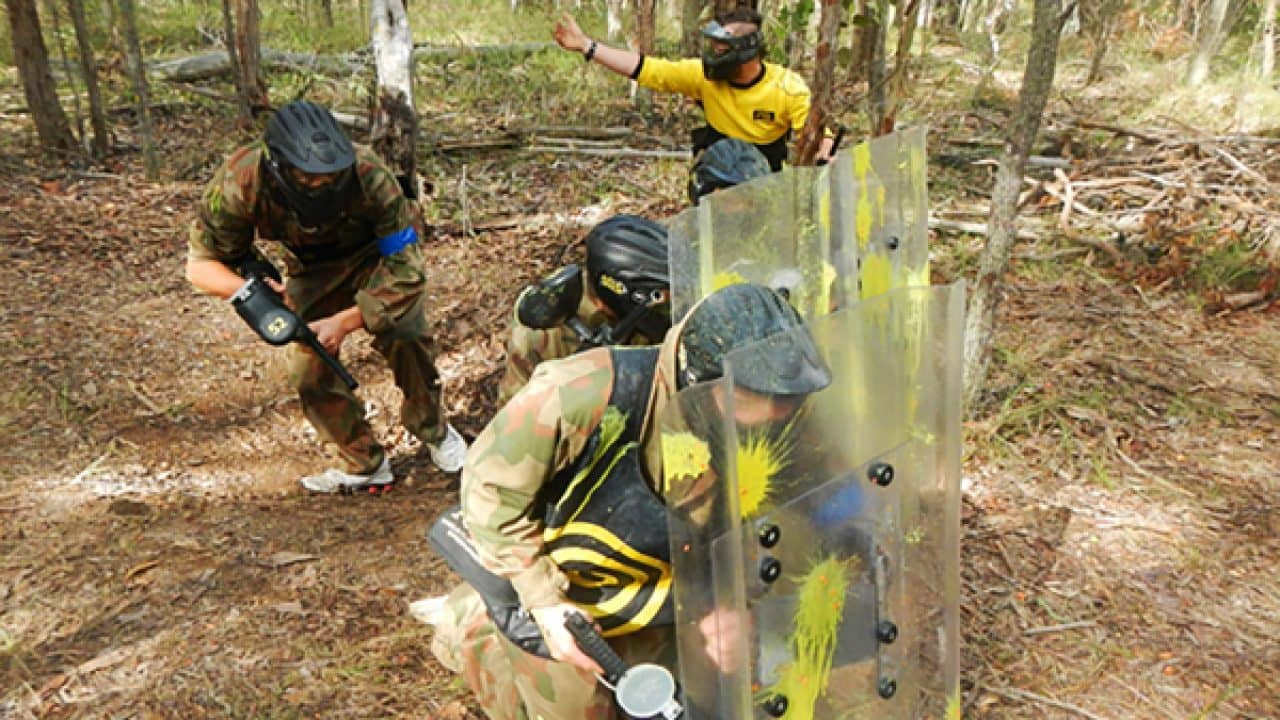 Delta Force Paintball Players Use Riot Shields On Game Zone