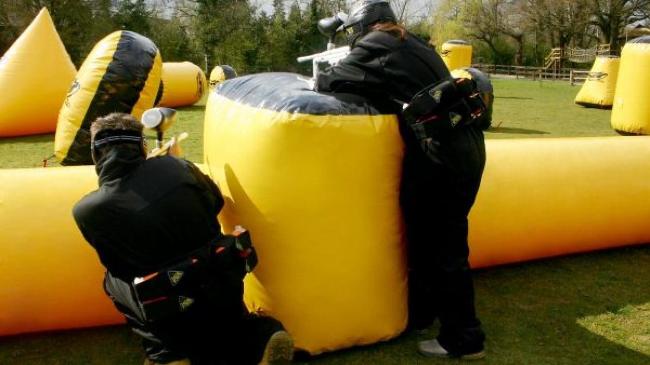 Delta Force Paintball Players Use Mobile Gate As Cover
