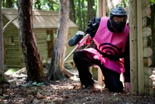 Paintball Player Dressed In Pink Target On Game Zone