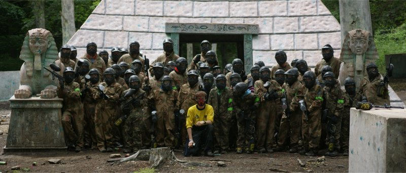 Group Posing By Pyramid Wearing Delta Force Paintball Uniform