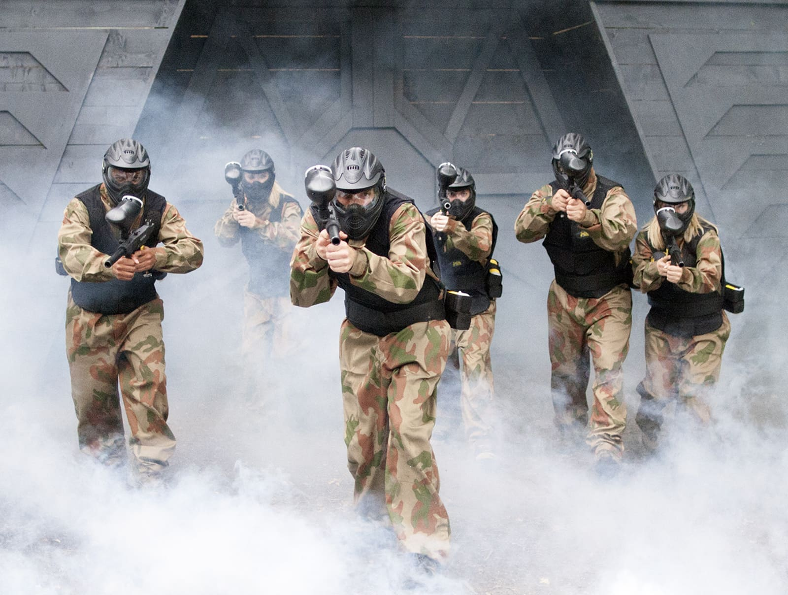 Squad of Paintball Players Advance from Space Warz Bunker