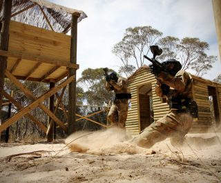 Delta Force Players Action Shot Kick Up Dust Vietcong Village