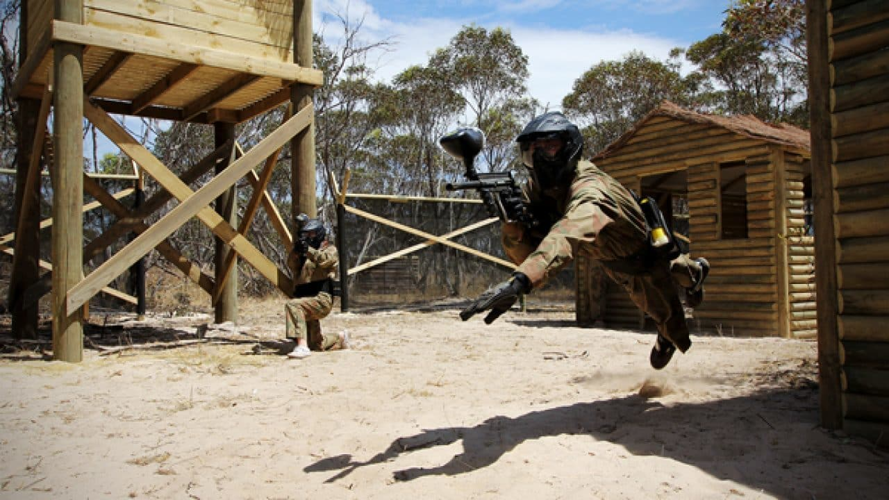 Delta Force Paintball Player Dives In Vietcong Village Game Zone