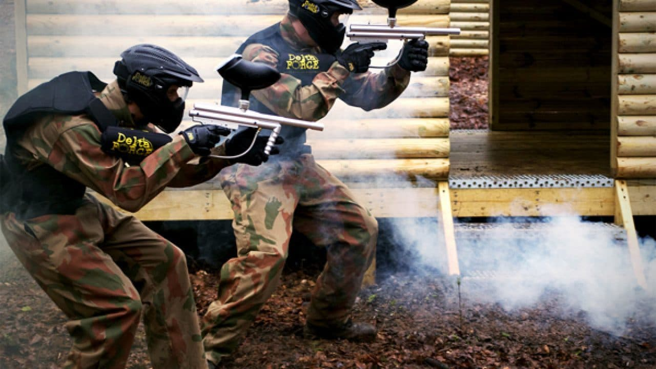 Two Delta Force Players Crouch With Smoke Vietcong Village