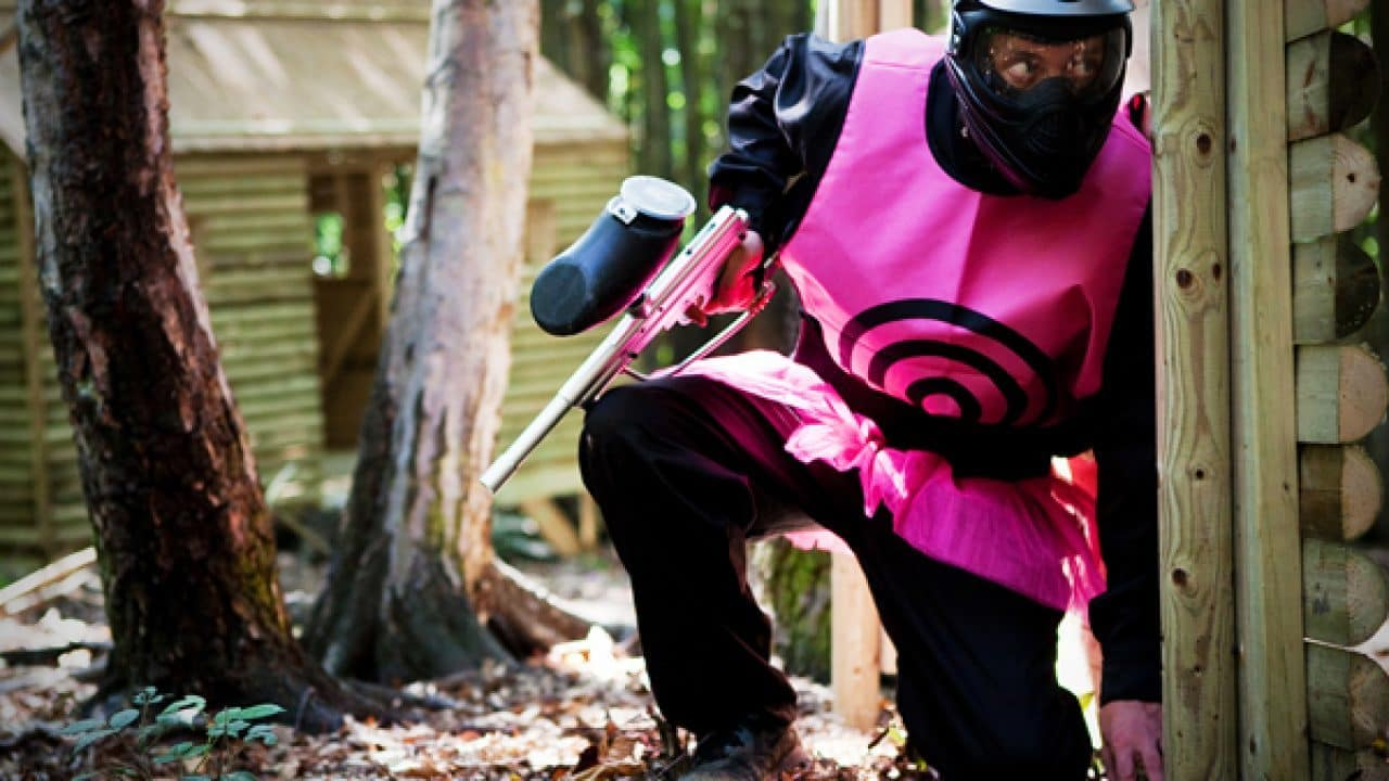 Delta Force Player Wearing Pink Target Hides Behind Cover