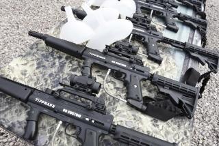 Row of Tippmann 98 Custom Paintball Guns