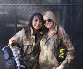 Two Girls Dressed In Camo Holding Delta Force Guns