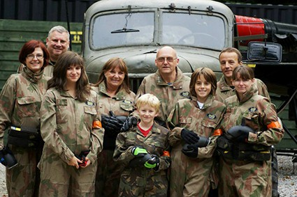 Family at Paintball Centre Pose in front of Truck
