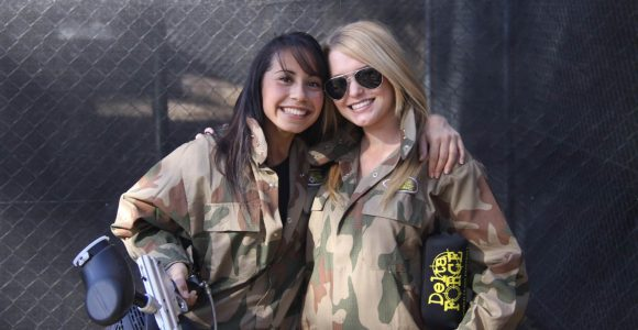 Two Girls In Delta Force Paintball Overalls