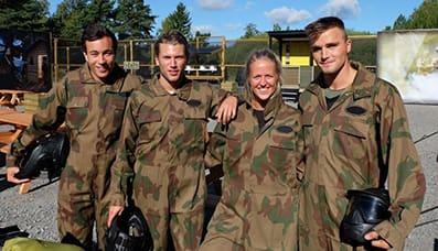 Friends smile at Delta Force base camp