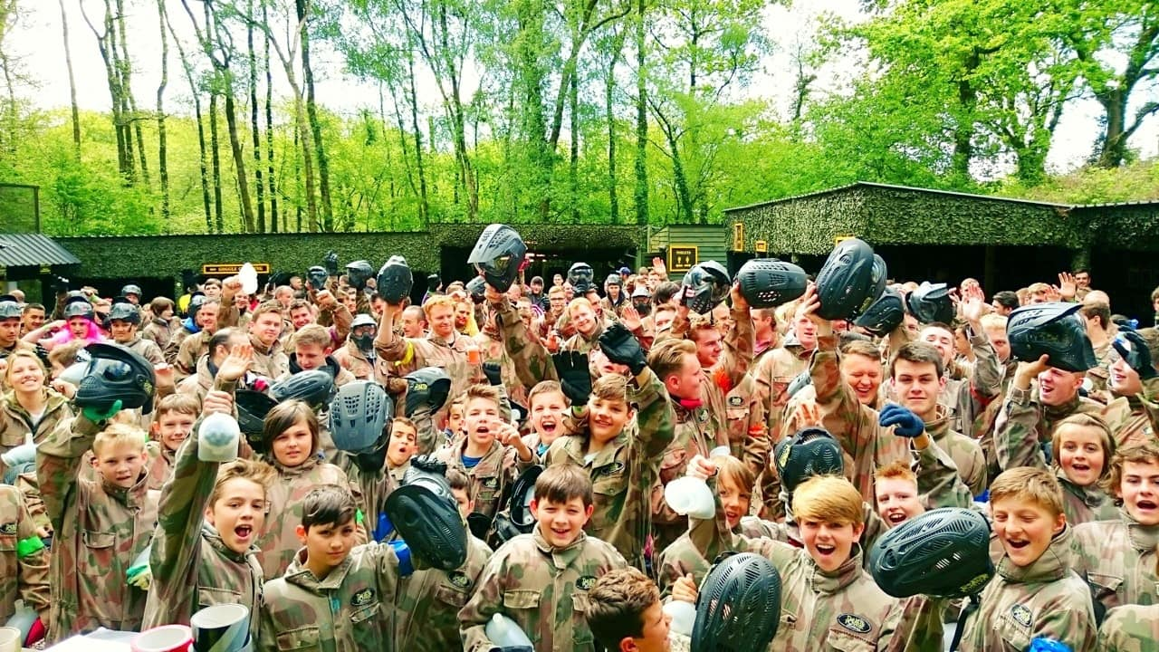 Paintball Players Raise Helmets in Celebration at Base Camp
