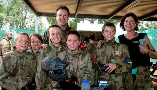 Family smiling at Delta Force base camp