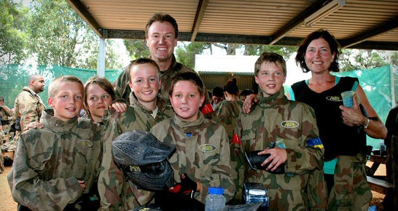 Family smiling at Delta Force Paintball base camp