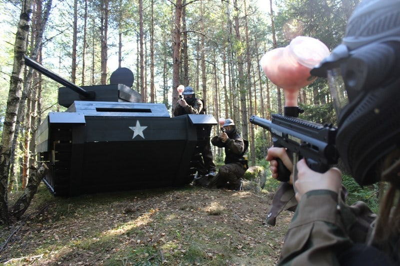 Paintball Players Exchange Fire Over a Tank