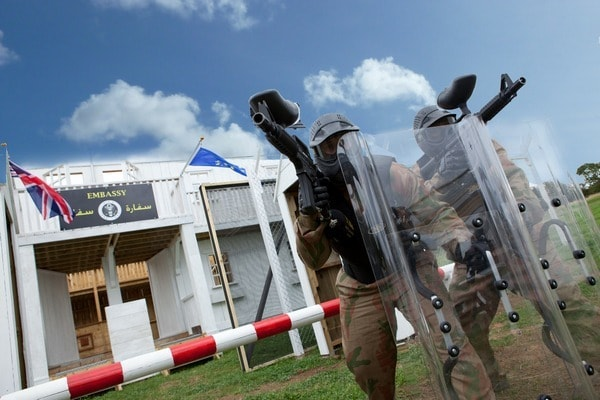 Paintball Players Defend the Embassy with Riot Shields