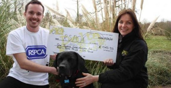 Delta Force Staff Holding Cheque With RSPCA