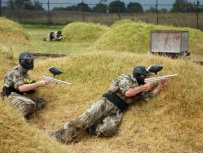 Paintball Players Crouching On Field