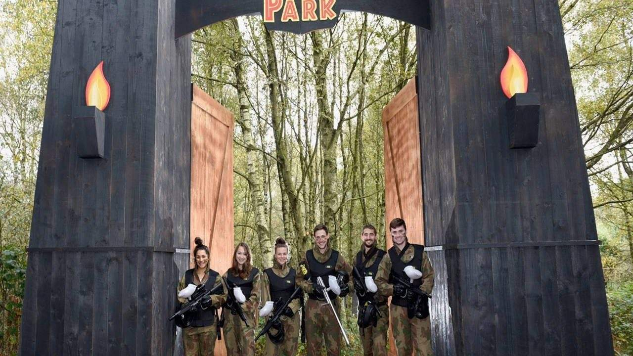 Delta Force players pose in the entrance to Raptor Park