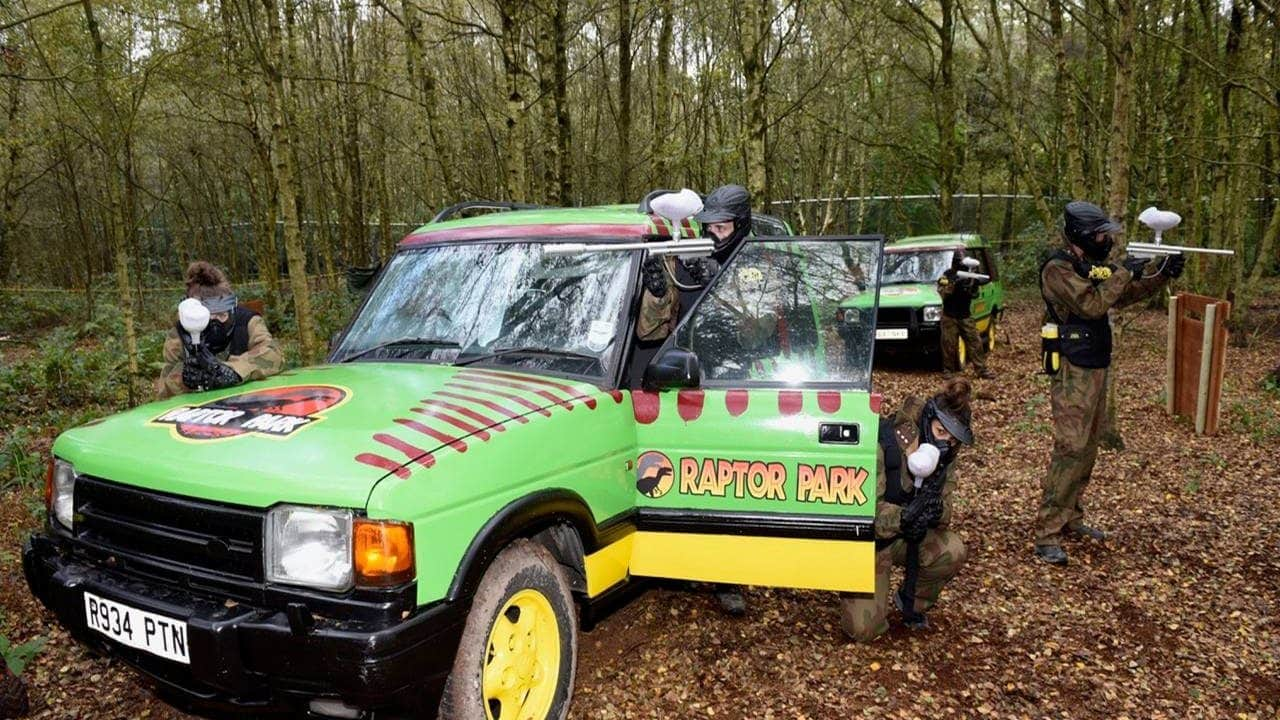 Players defend an abandoned Raptor Park vehicle