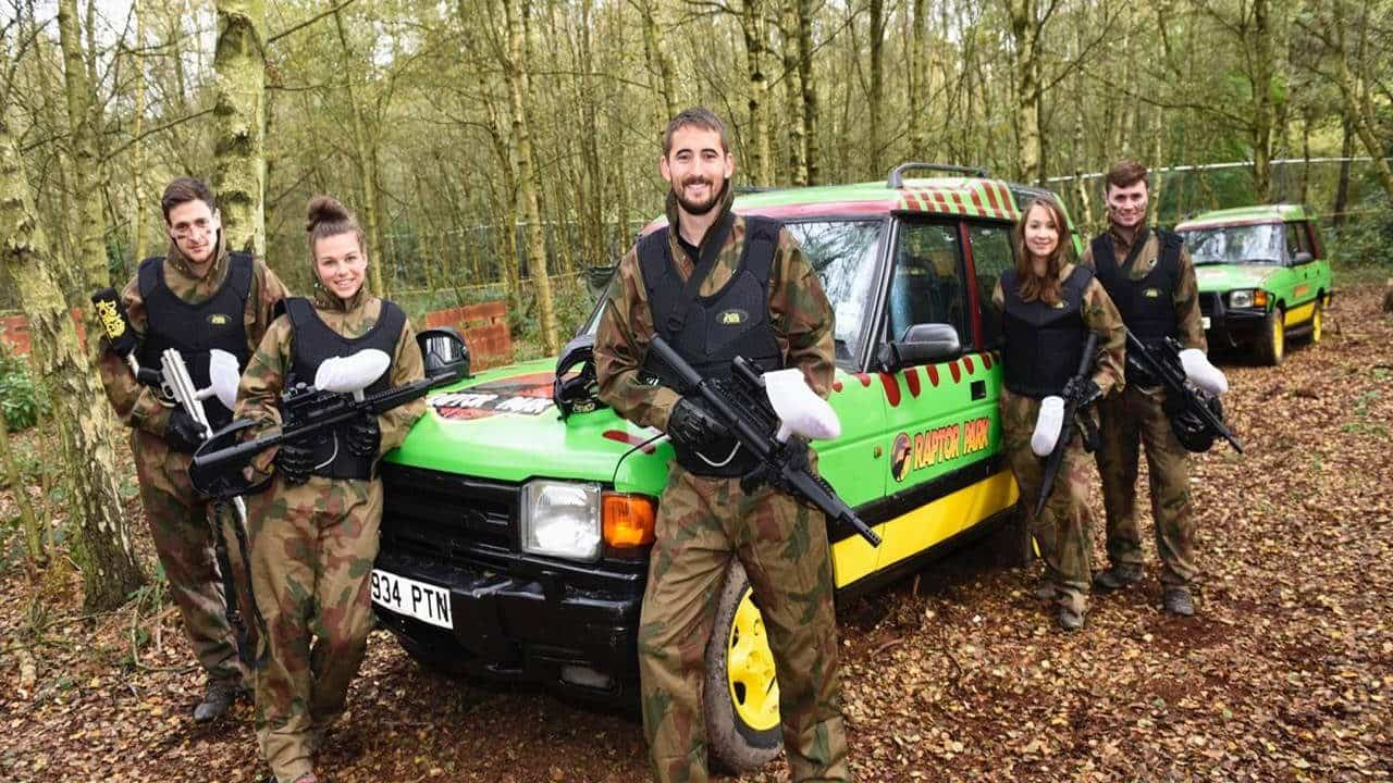 Delta Force players smile in front of Raptor Park truck