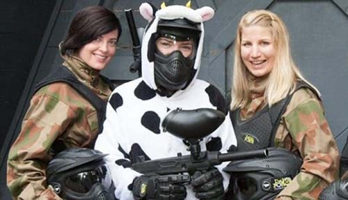 Bride in cow onesie poses with two friends